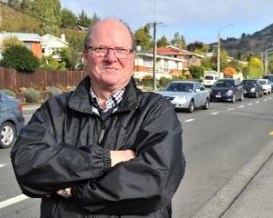 Mosgiel-Taieri Community Board chairman Bill Feather checks out the traffic in Quarry Rd, near...