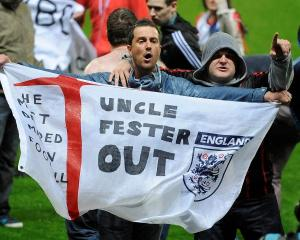 Blackburn Rovers fans protest on the pitch after their team lost to Wigan Athletic in their...