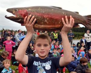 Blake Rackham, of Dunedin, shows off his 5kg rainbow trout caught yesterday in the Southern...
