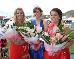 Blossom Festival queen winner Vikki Sanson (centre), flanked by second-placegetter Shaun Robinson...