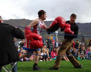 Boxing busker and professional clown Fraser Hooper (left), of Wellington, takes on Wanaka man...