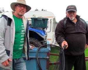 Brent Godfery, from Oamaru, left, and Jim O'Connor, from Christchurch, pack up after spending the...