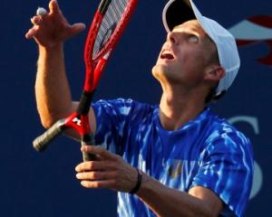 Brian Battistone of the US plays in his mixed doubles match with a two-handled racquet at the US...