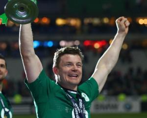 Brian O'Driscoll celebrate with the trophy after Ireland won the Six Nations championship with a...