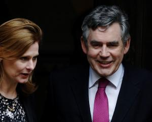 Britain's former Prime Minister Gordon Brown and wife Sarah leave the Leveson Inquiry at the High...