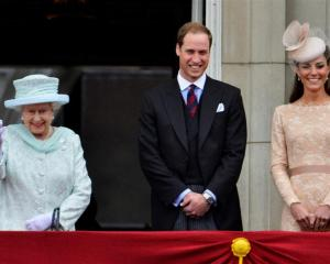 Britain's Queen Elizabeth waves next to Prince William and Catherine, Duchess of Cambridge, on...