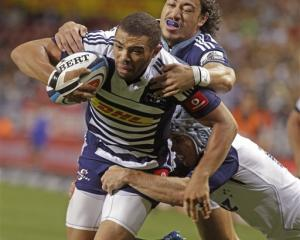 Bryan Habana, left, of the Stormers makes his way to the tryline in the tackle of Ben Lam, of the...