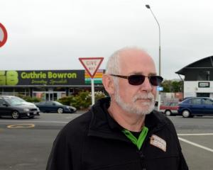 Businessman Marty Hay near the intersection he says is unsafe. Photo by Peter McIntosh.