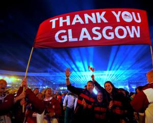 Canadian athletes wave during the closing ceremony of the Commonwealth Games at Hampden Park in...