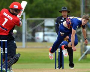 Canterbury batsman Logan van Beek is beaten by a delivery from Otago speedster Warren Barnes in...