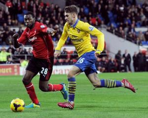 Cardiff City's Kevin Theophile-Catherine (L) challenges Arsenal's Aaron Ramsey. REUTERS/Rebecca...