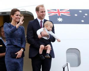 Catherine, Duchess of Cambridge, Prince William, Duke of Cambridge and Prince George of Cambridge...