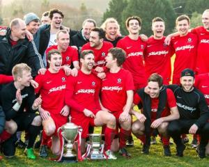 Caversham players celebrate another Football South Premier League title at Sunnyvale on Saturday....