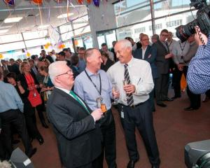 Celebrating the successful listing of Z Energy are (from left) NZX chief executive Tim Bennett, Z...