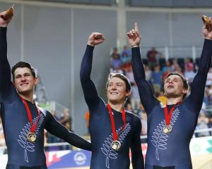Celebrating their win in the men's team sprint finals  are (l-r) New Zealand's Ethan Mitchell,...