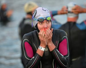 Carrie Lester, from Australia, warms her hands before the start at Challenge Wanaka on Saturday.