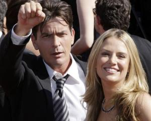 Charlie Sheen and Brooke Mueller arrive at the 59th Primetime Emmy Awards in Los Angeles in May...