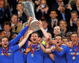 Chelsea players celebrate with the trophy after defeating Benfica in the Europa League final at...