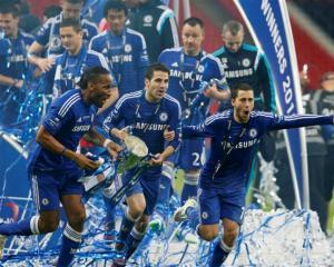 Chelsea players (l-r) Didier Drogba, Cesc Fabregas and Eden Hazard celebrate their team's League...