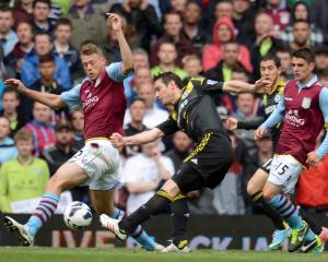 Chelsea's Frank Lampard shoots to score watched by Aston Villa's Nathan Baker (L) during their...