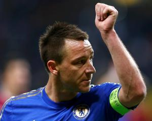 Chelsea's John Terry acknowledges fans after the Europa League quarter-final second leg match...