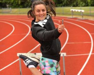 Christina Ashton celebrates her NCEA results during a hurdle training session at the Caledonian...