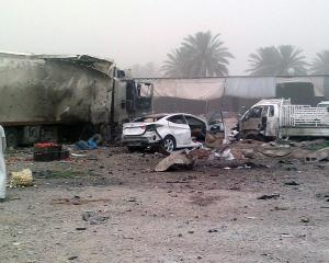 Civilians gather at the site of a car bomb attack at Jadidat al-Shatt in Diyala province, 40km...