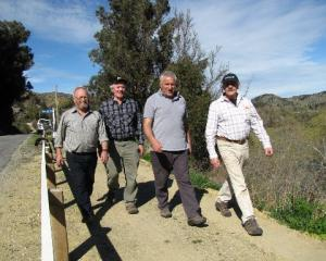 Clutha Gold Trail Charitable Trust members (from left) Stu Edgecumbe, of Roxburgh East, chairman...