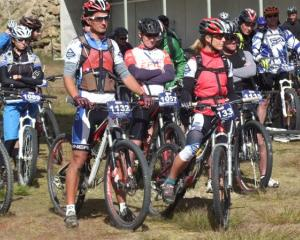 Competitors wait for the start of the Big Easy mountain bike race on the Pisa range on Saturday....