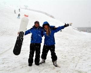 Coronet Peak lift operators Charlie Mallon and Gill Swinton rejoice in the snowfall yesterday...