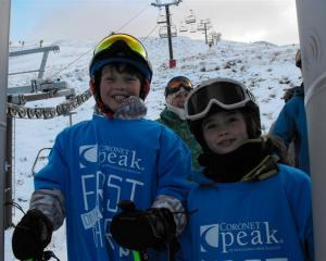Cougar (left) and Tallulah Bryant proudly wear their special T-shirts after being first on the...