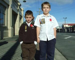 Cousins Seth Rogan (6), of Milton with his great-great-great-uncle's medal, and Jordan Rogan (9),...