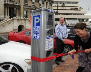 Cr Jinty McTavish cuts the ribbon on the council's new solar-powered ticketless parking meter,...