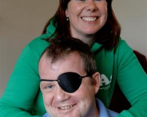 Crash survivor Mark Halliwell and his partner Anna Morgan before leaving Dunedin yesterday. Photo...