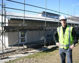 Cromwell College executive officer Rowan Dunnet studies progress on the school's new junior...