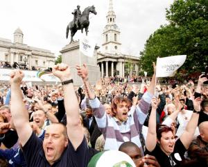 Crowds in London's Trafalgar Square celebrate as the announcement is made that London will host...