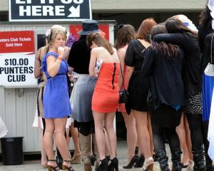 Crowds queue to join the punters club at Wingatui yesterday. Photo by Peter McIntosh.