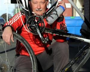 Cyclist Pascal Sutherland holds his bike, which was damaged when a motorist ran over it on...
