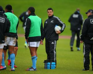Dan Carter helps deliver water during an All Black training session at Trusts Stadium in Auckland...