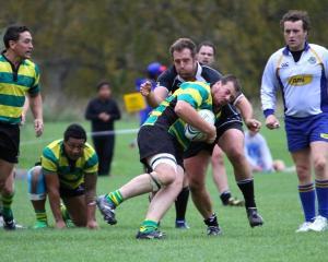 Daniel Johnson tackles Green Island prop Simon McCarthy.