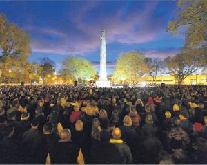 Dawn breaks over the cenotaph in Dunedin as a large crowd commemorates Anzac Day. Photo: Gerard O...