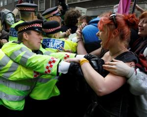 Demonstrators scuffle with police during a protest by the Occupy movement in London.  REUTERS...