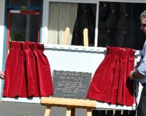 Dion Latta's parents, Sue and Logan Latta, unveil the memorial plaque to their son at John...