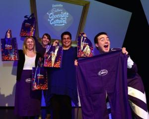 Dominic Tay (right), dressed as Cadbury Joyville character Derek Valentine, celebrates the launch...