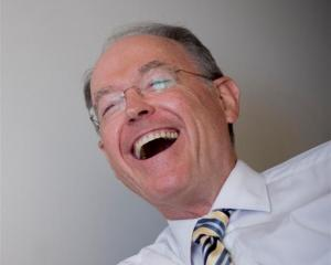 Don Brash has a laugh while being interviewed in his apartment in Newton yesterday. Photo by <i...