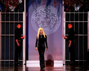 Donatella Versace acknowledges the audience at the end of the Versace Autumn/Winter 2014...