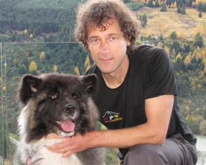 Dr Geoff Woodhouse, of Remarkable Vets Arrowtown, with Gypsy, the 3-year-old Japanese Akita dog...
