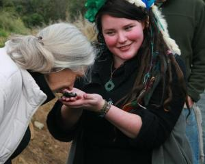 Dr  Jane Goodall  on a previous visit to Orokonui, gets to smell Kiwi poo. Photo by Neville Peat.