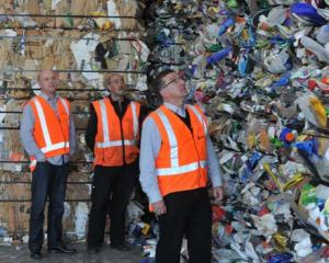 Dunedin City Council solid waste manager Ian Featherston examines the 120-tonne pile of...