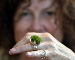 Dunedin jeweller Lynn Kelly with a ring she made from silver and live moss, part of her Other...